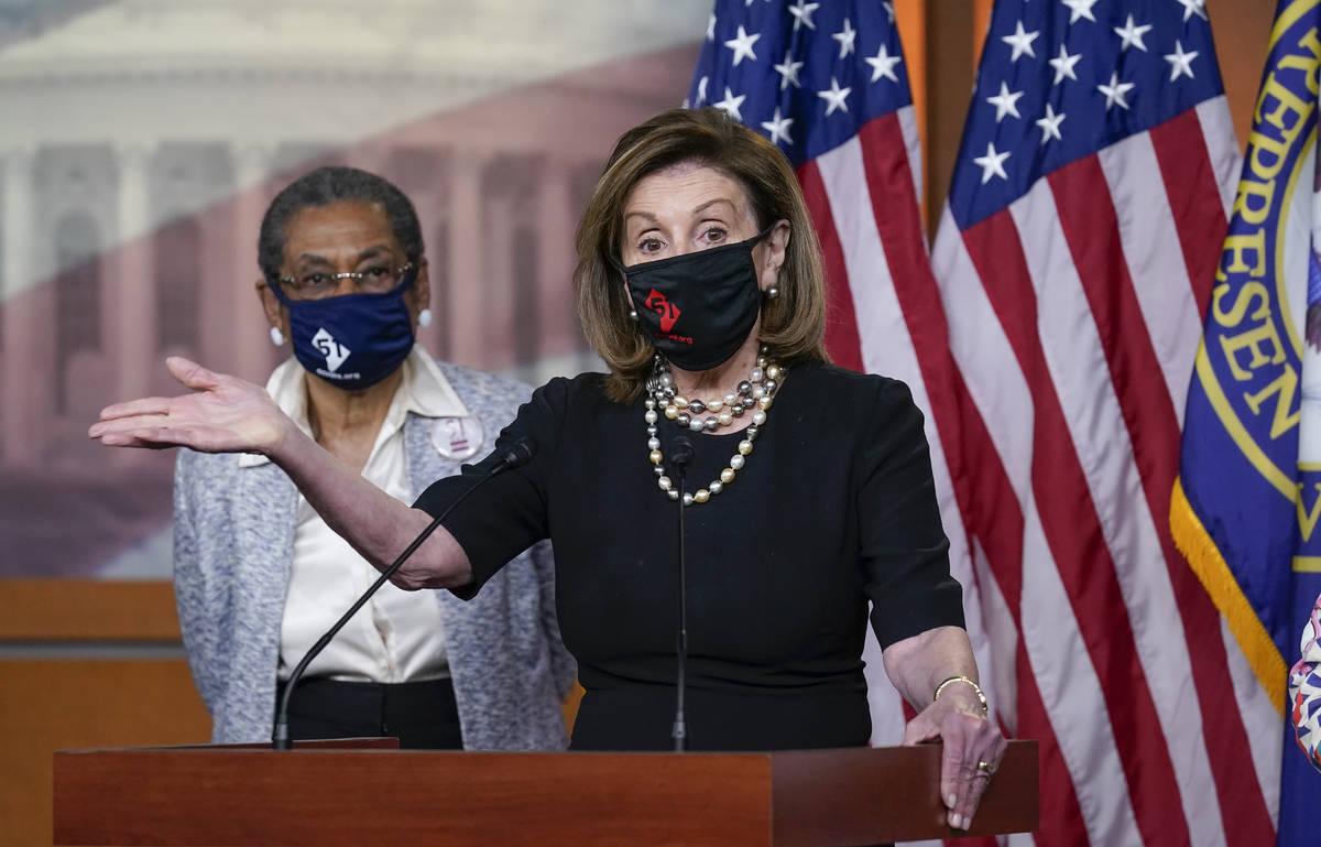 In this April 21, 2021, photo, House Speaker Nancy Pelosi, D-Calif., joins Del. Eleanor Holmes- ...
