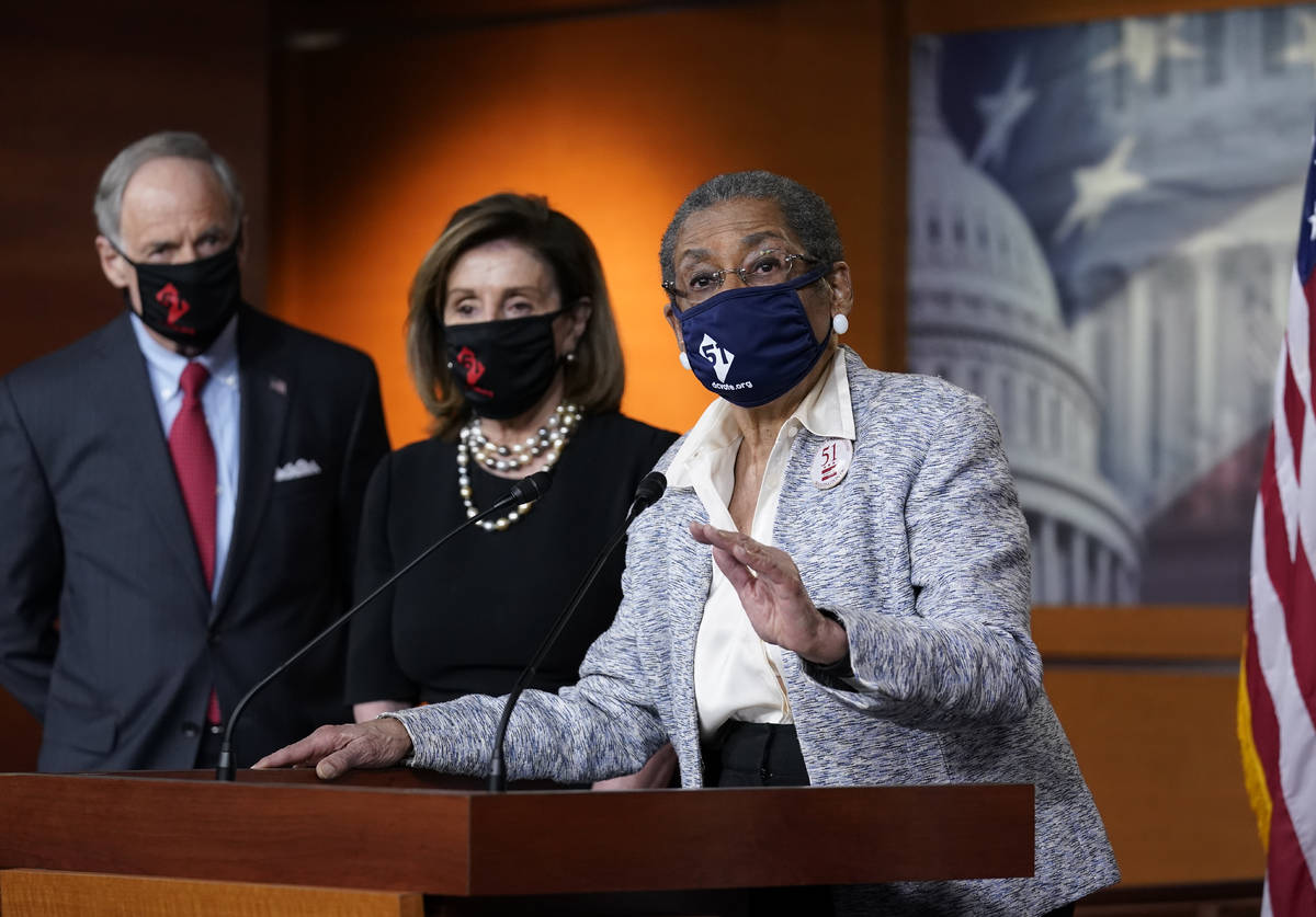 In this April 21, 2021, photo, Del. Eleanor Holmes-Norton, D-D.C., center, joined from left by ...