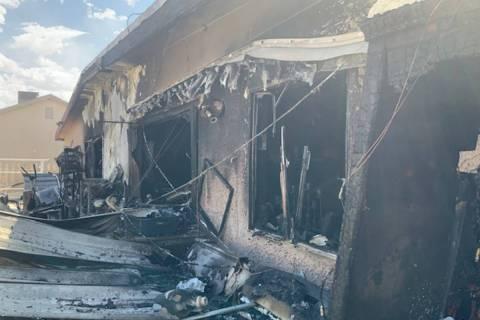 Crews battle a house fire Thursday, April 22, 2021, on the 2000 block of Las Verdes Street in L ...