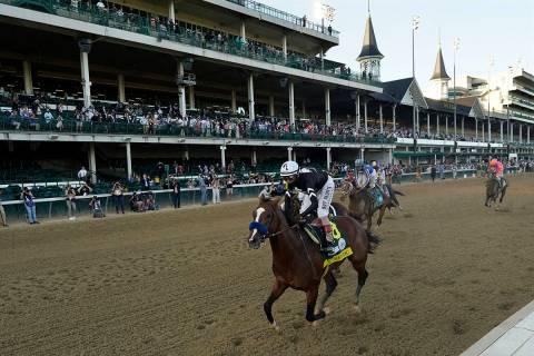 Jockey John Velazquez riding Authentic, wins the 146th running of the Kentucky Derby at Churchi ...