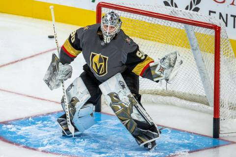 Golden Knights goaltender Robin Lehner (90) stops a puck from a teammate during the warm ups of ...