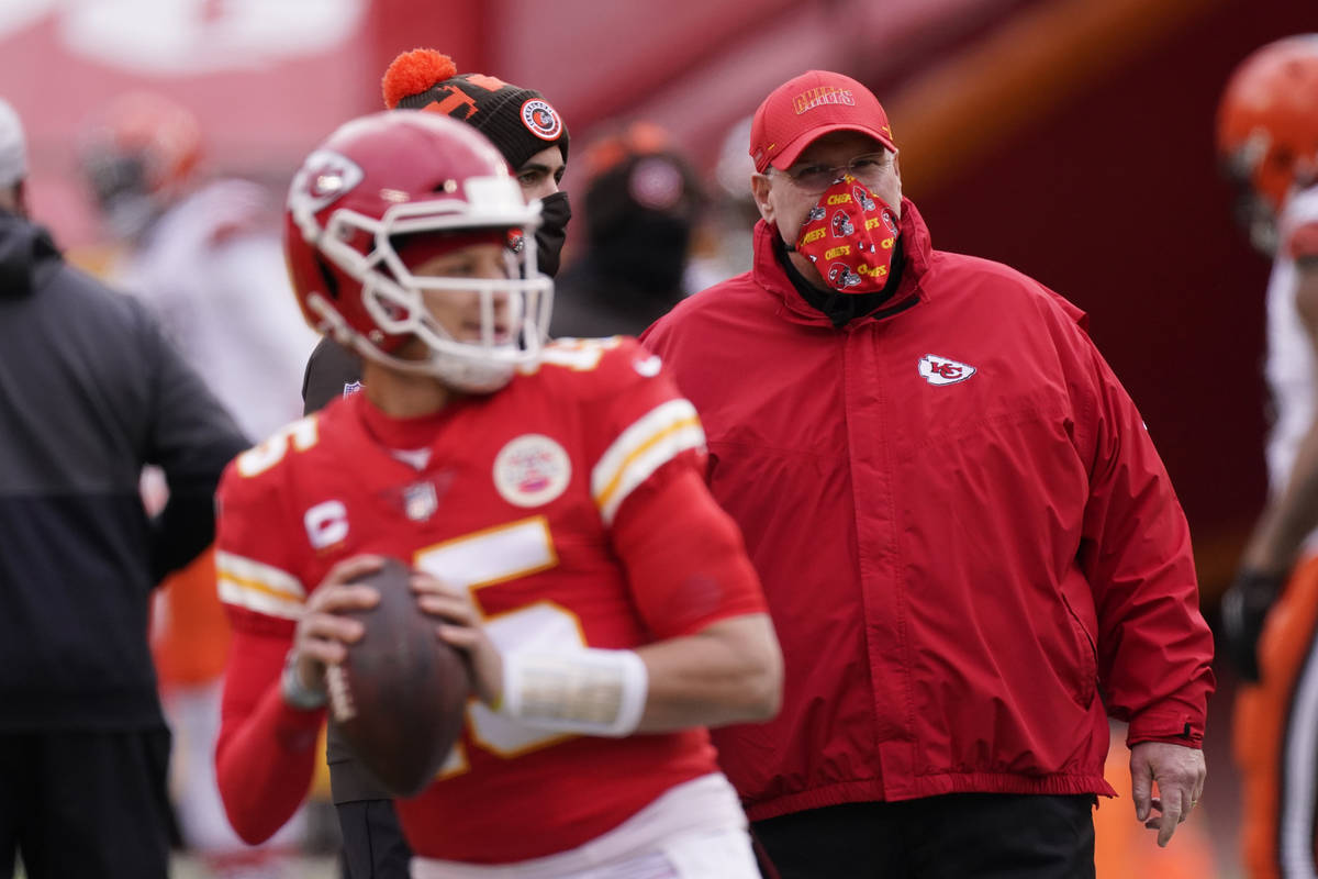 Kansas City Chiefs head coach Andy Reid, right, watches quarterback Patrick Mahomes warm up bef ...