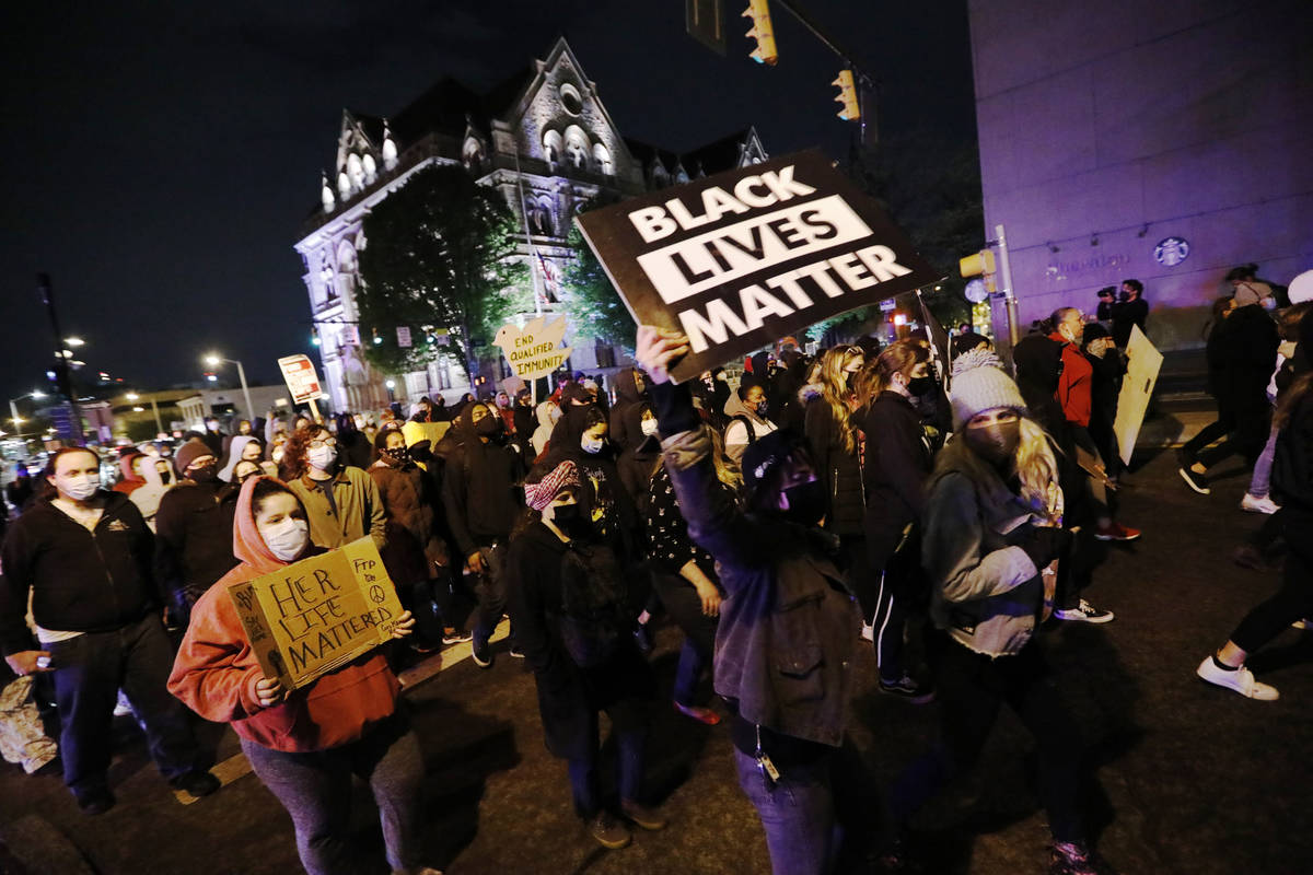 Protesters march in downtown Columbus, Ohio, Tuesday, April 20, 2021. Police shot and killed a ...