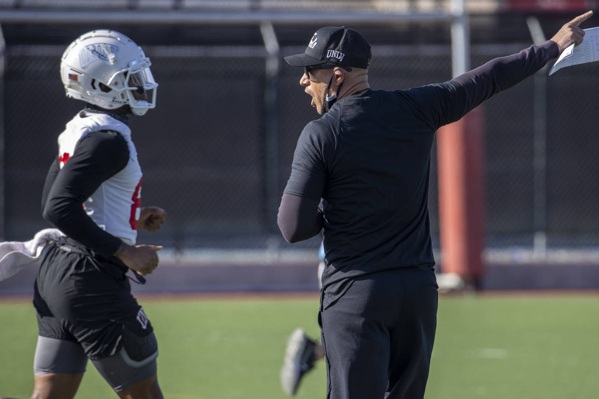 UNLV head coach Marcus Arroyo yells instructions during the first spring football practice at R ...