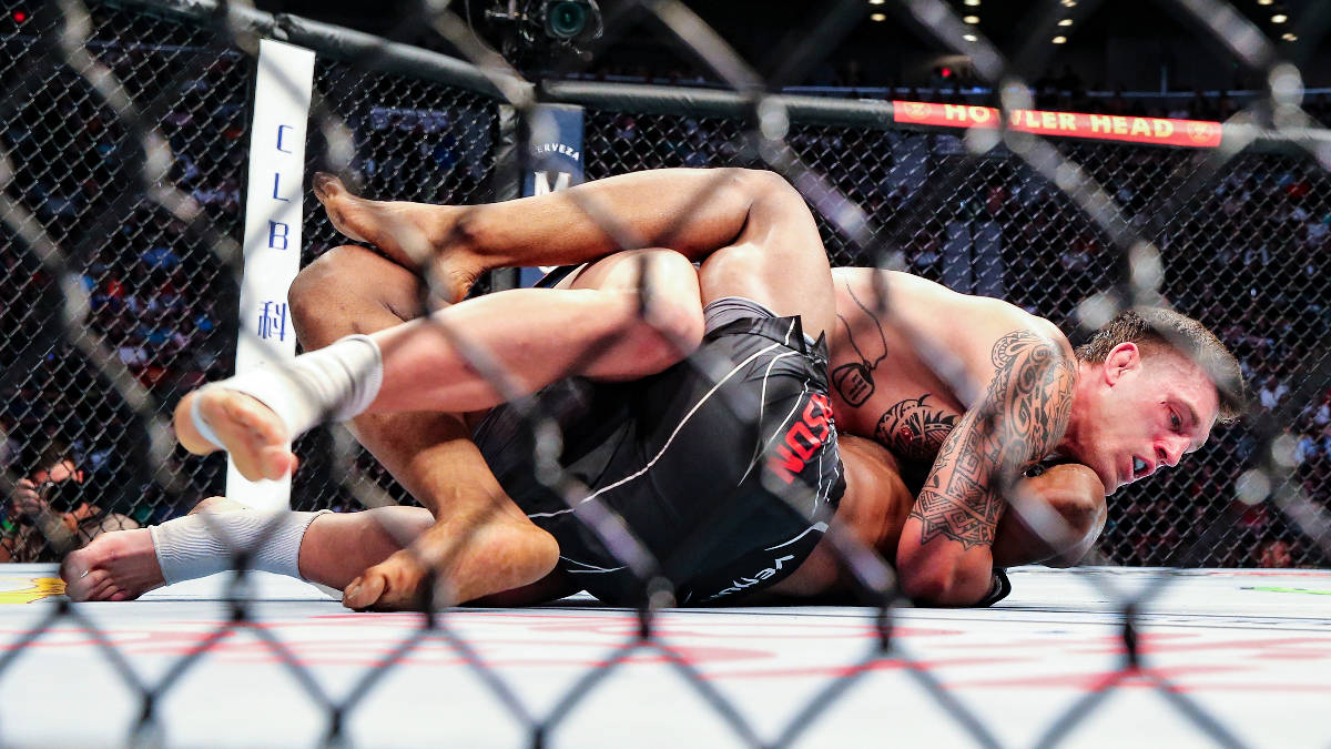 Brendan Allen, top, looks for a submission hold on Karl Roberson during a UFC 261 mixed martial ...