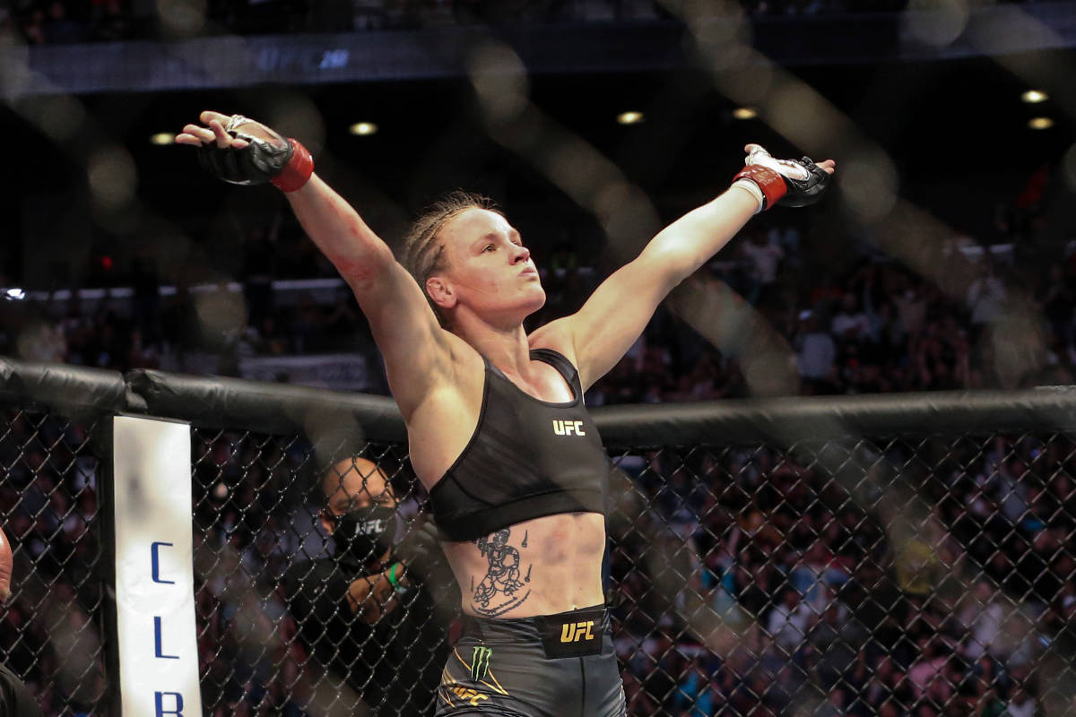 Valentina Shevchenko celebrates her win at the end of her UFC 261 mixed martial arts bout again ...
