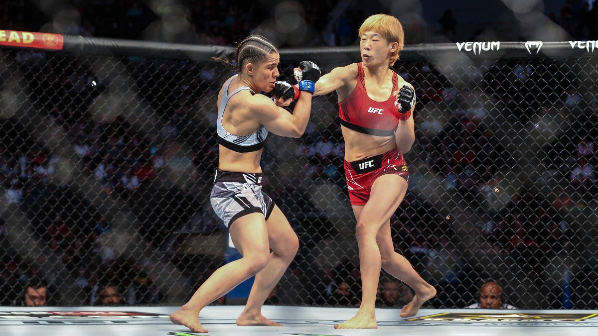 Ariane Carnelossi, left, takes a punch from Liang Na, right, during a UFC 261 mixed martial art ...