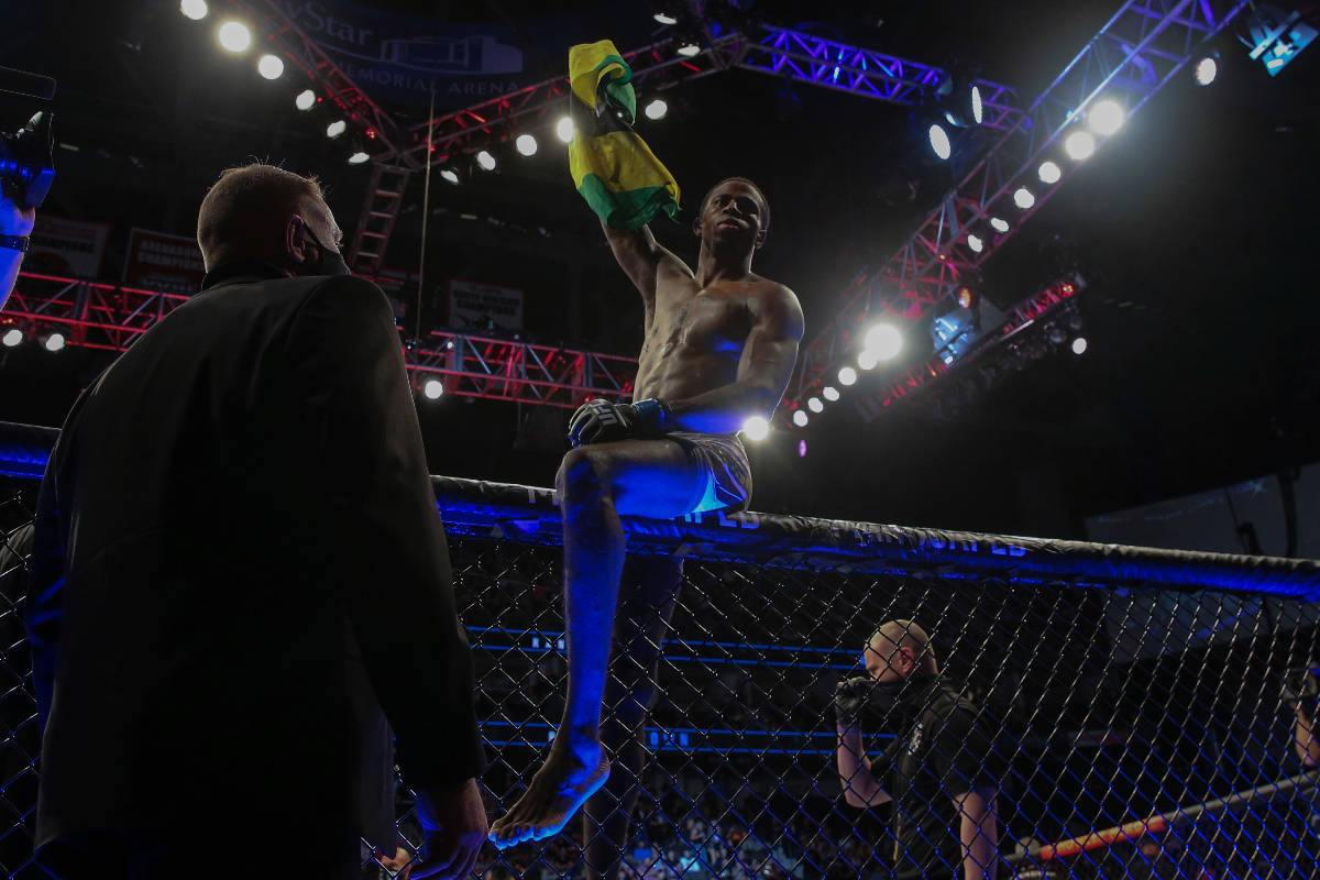 Randy Brown hops atop the octagon fence after winning his UFC 261 mixed martial arts bout, Satu ...