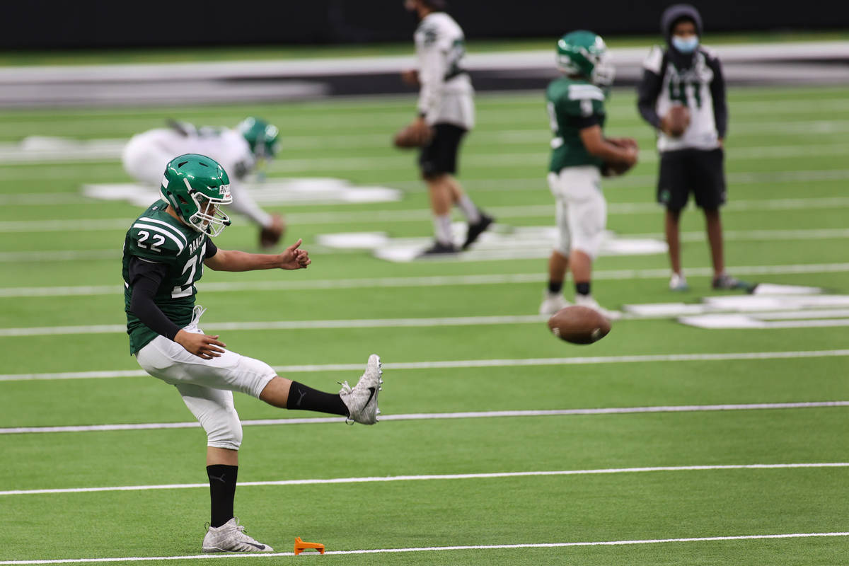 Rancho's Chris Aviles (22) works on his kicks during a team football practice at Allegiant Stad ...