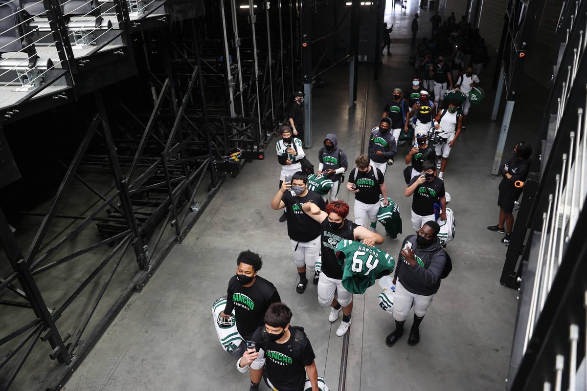 Rancho players enter Allegiant Stadium in Las Vegas for a team football practice, Saturday, Apr ...