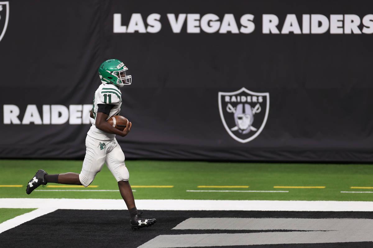 Rancho's Malik McHugh (11) runs for a touchdown during a team football practice at Allegiant St ...