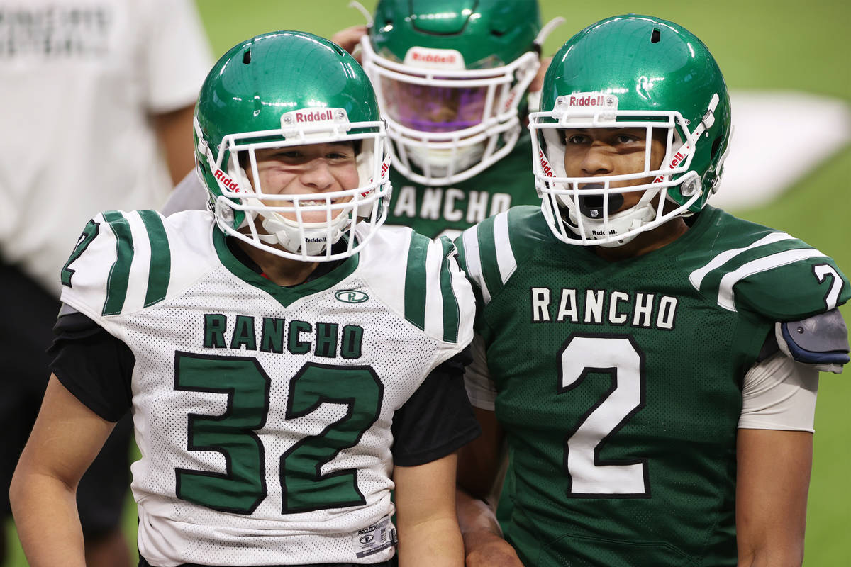 Rancho's Elijah Pittack (32) and Raymond Conner (2) talks to each other during a team practice ...