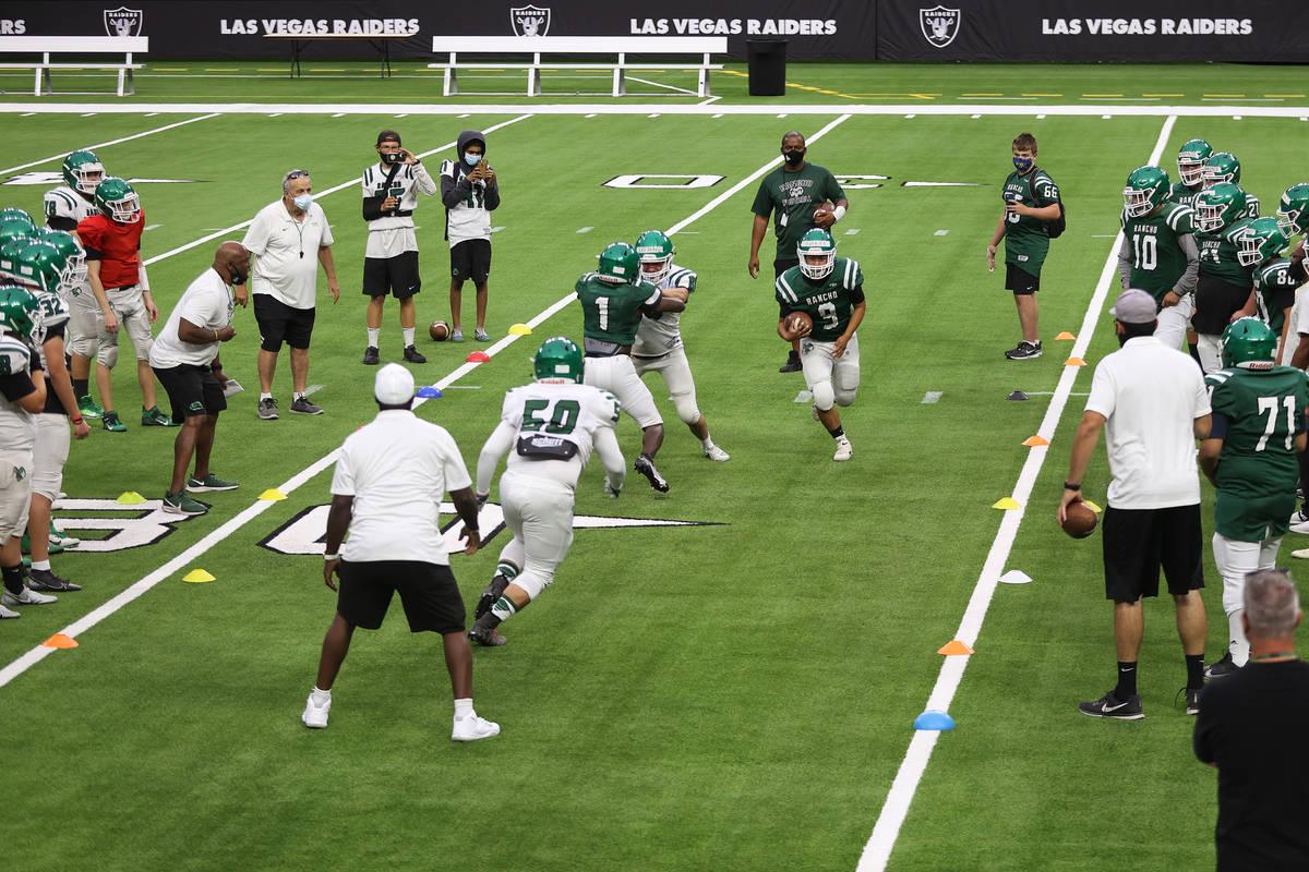 Rancho's Chris Solis (9) runs the ball during a team practice at Allegiant Stadium in Las Vegas ...