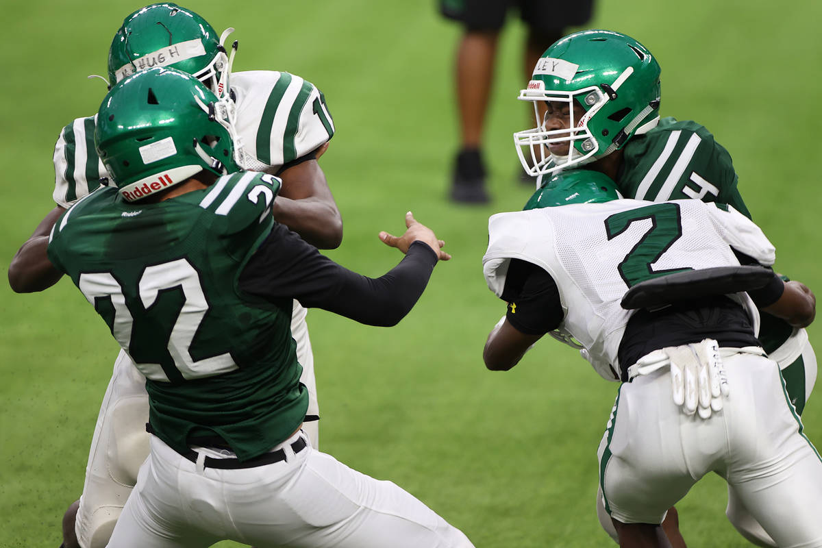 Rancho's Malik McHugh (11) defends against Chris Aviles (22) as Sircory Daley (4) is tackled by ...