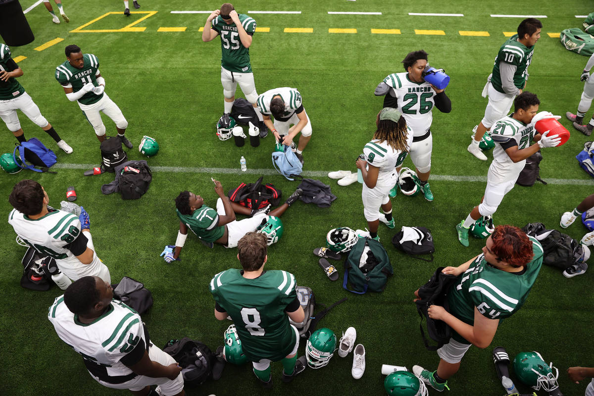 Rancho players take a water break during a team football practice at Allegiant Stadium in Las V ...
