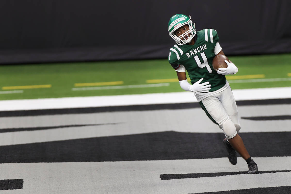 Rancho's Sircory Daley (4) runs the ball to the end zone during a team football practice at All ...