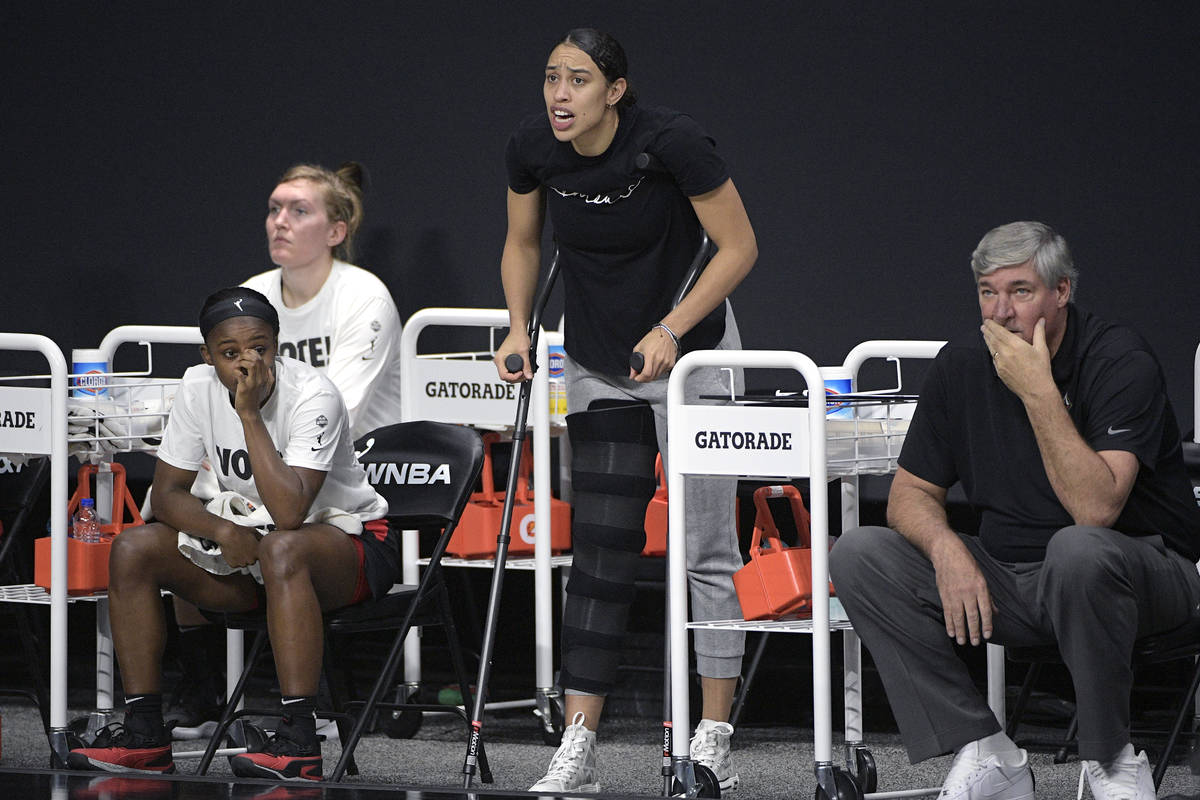 Las Vegas Aces forward Dearica Hamby, center, calls out words of encouragement from the bench a ...