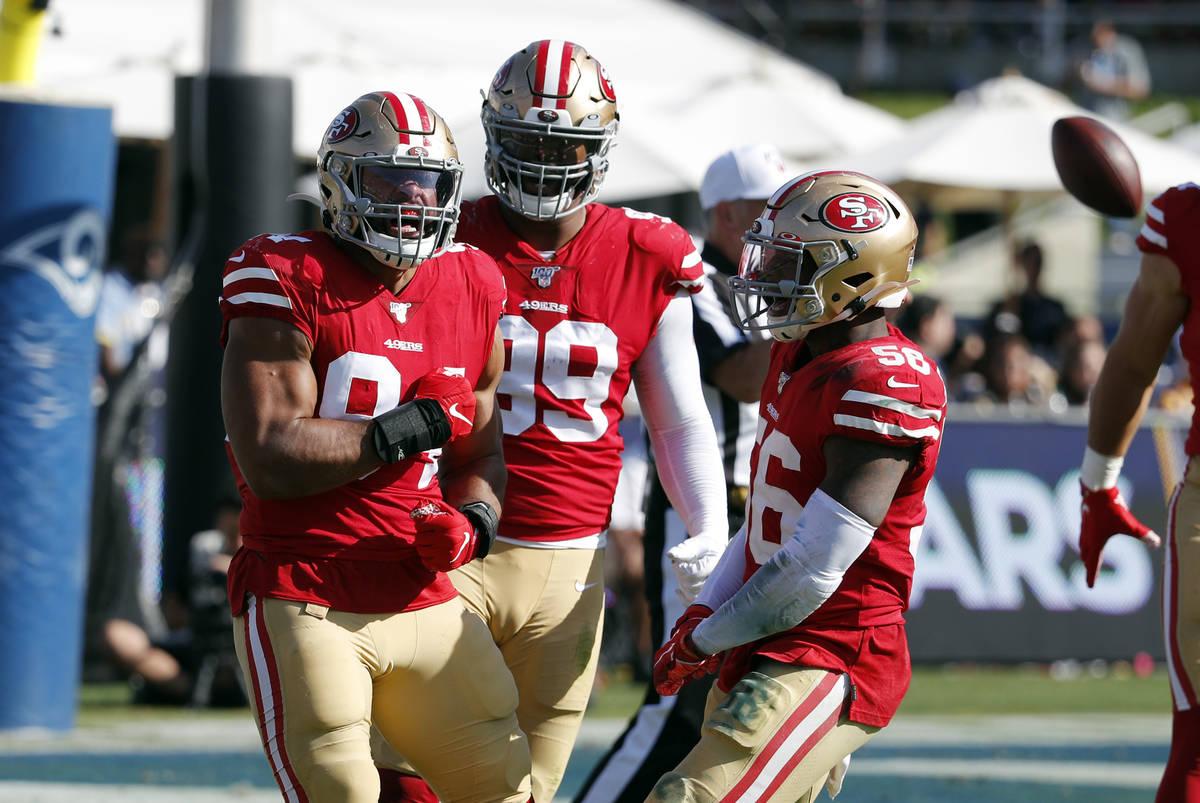 San Francisco 49ers defensive end Solomon Thomas, left, celebrates after sacking Los Angeles Ra ...