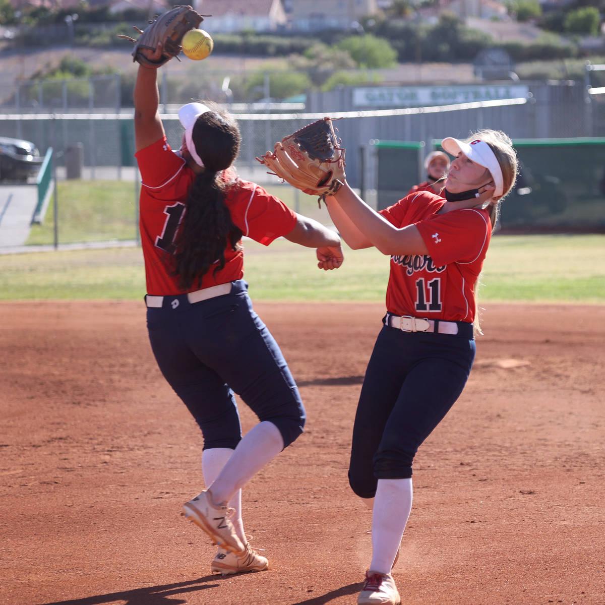Coronado's Jasmyn Lara (15) and Kendall Selitzky (11) miss a fly ball for a Green Valley single ...
