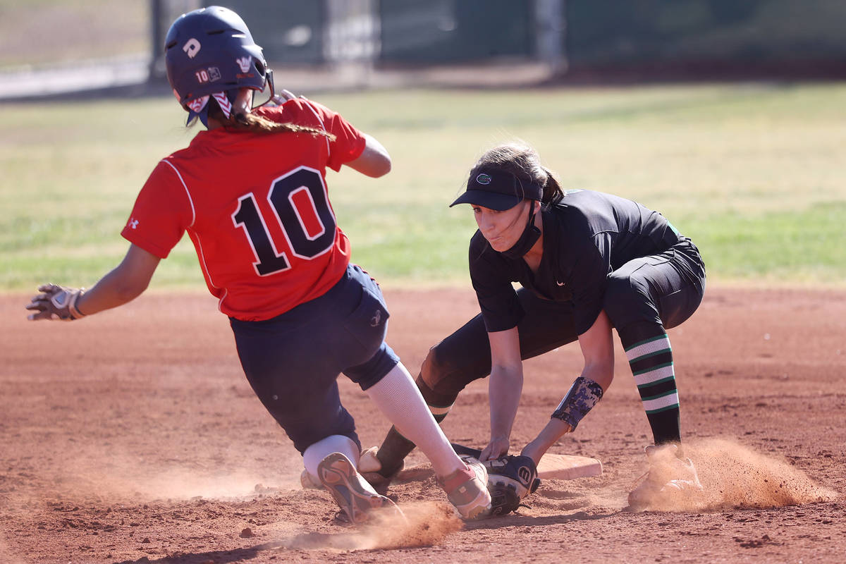 Green Valley's Mickey Morris (3) tags out Coronado's Sydney Smith (10) to end the top of the si ...