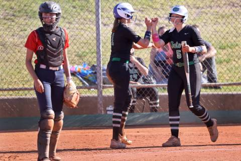 Green Valley's Avari Morris (1), center, celebrates a run with teammate Ava Mearideth (5) as Co ...