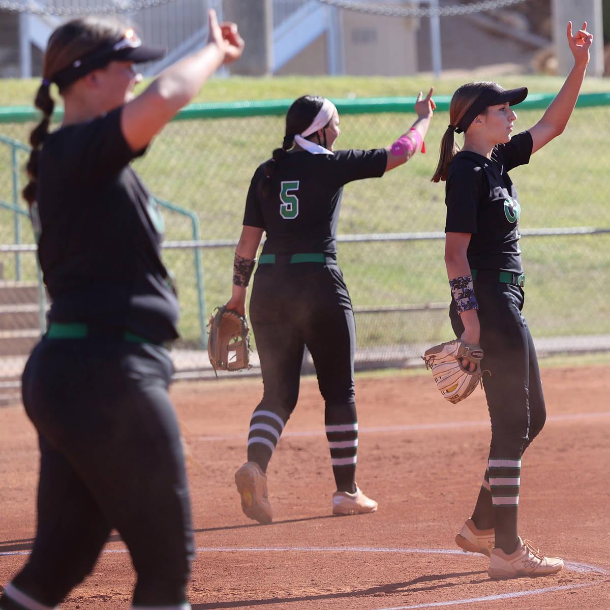 Green Valley's pitcher Avari Morris (1), right, Ava Mearideth (5) and Alicia Ortega (15), gestu ...