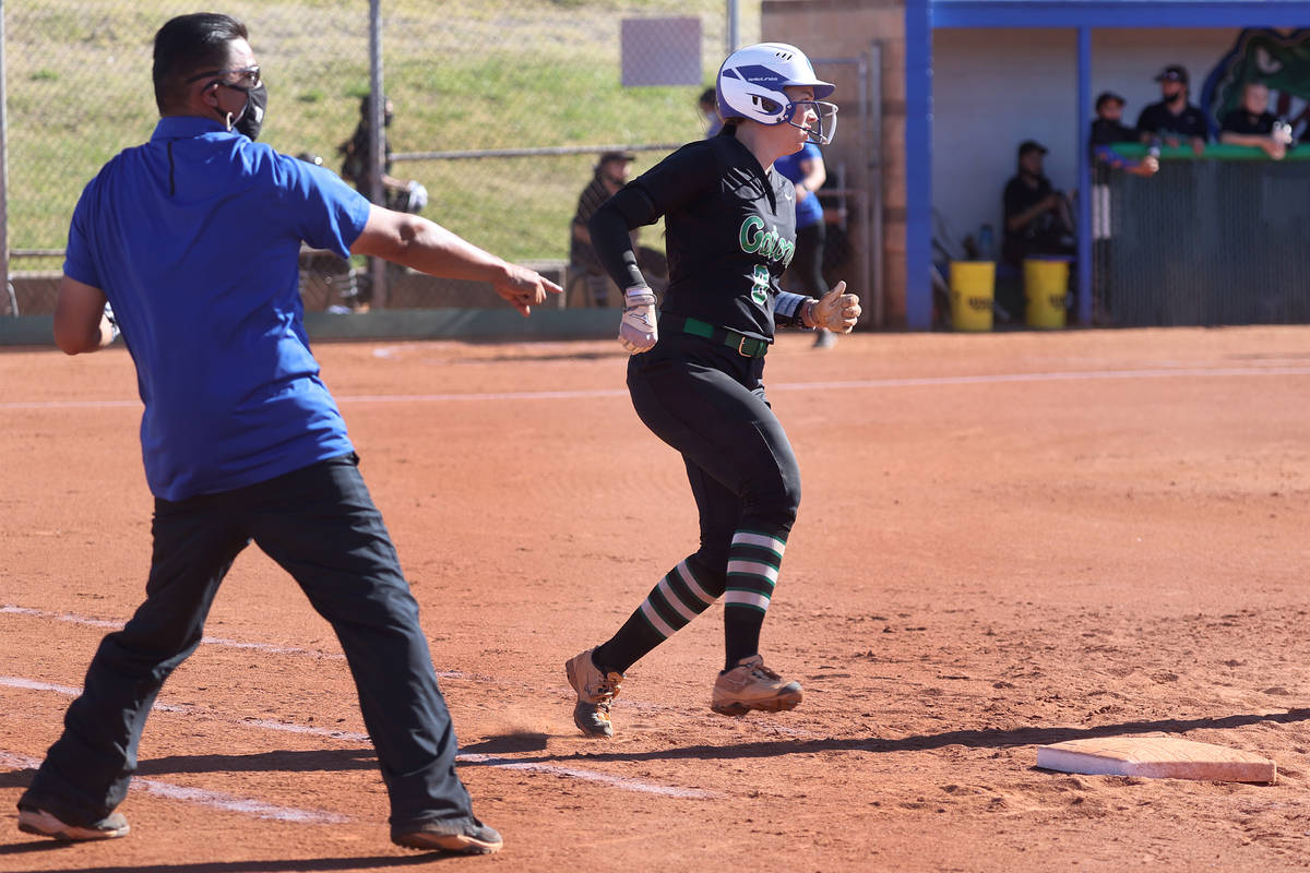 Green Valley's assistant coach Tony Perez points to first base after a single hit by Angelina O ...