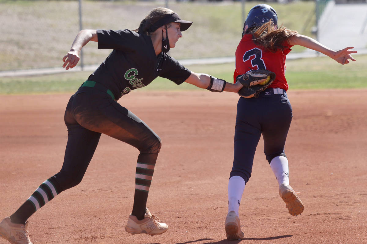 Green Valley's Mickey Morris (3) tags Coronado's MaKala Reynolds (3) for an out in the third in ...