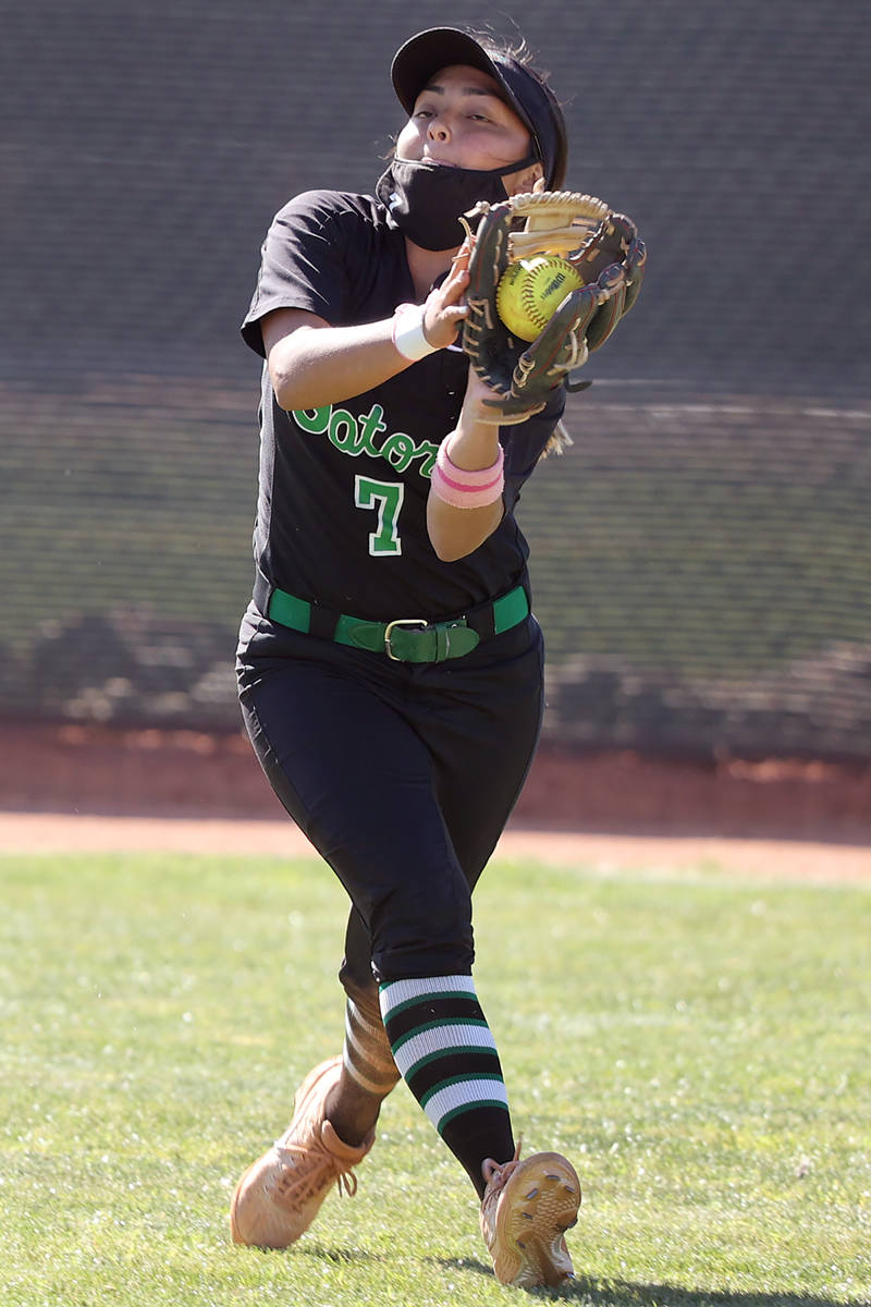 Green Valley's Cindy Martinez-Escamilla (7) makes a catch for an out in the outfield in the sev ...
