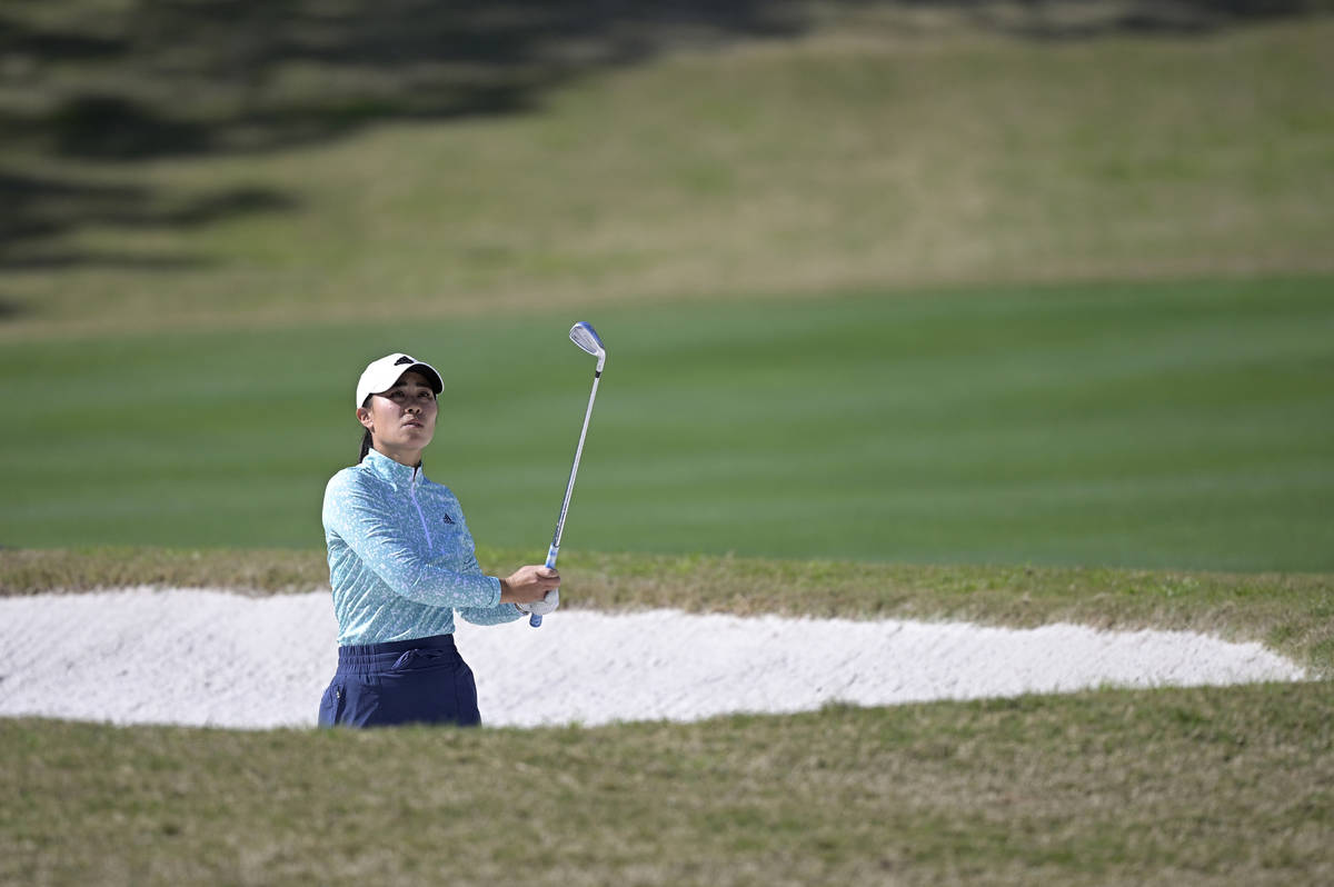 Danielle Kang watches after hitting out of a bunker onto the fourth green during the final roun ...