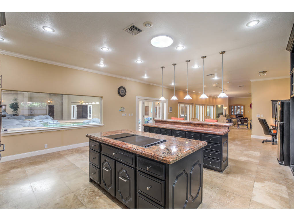 Islands in the kitchen of 2525 Driftwood Drive. (Brian Mannasmith/Neon Sun Photography)