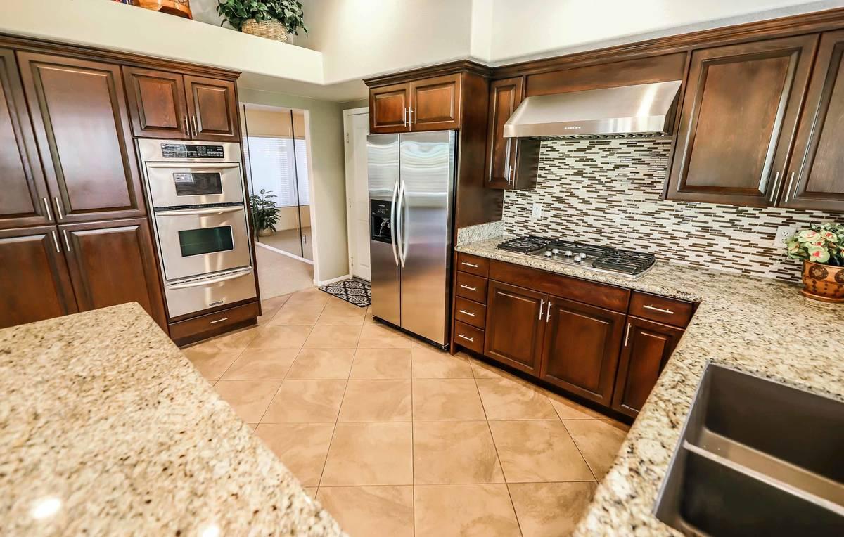 The kitchen of 8812 Saint Pierre Drive. (SugarMill Studios)