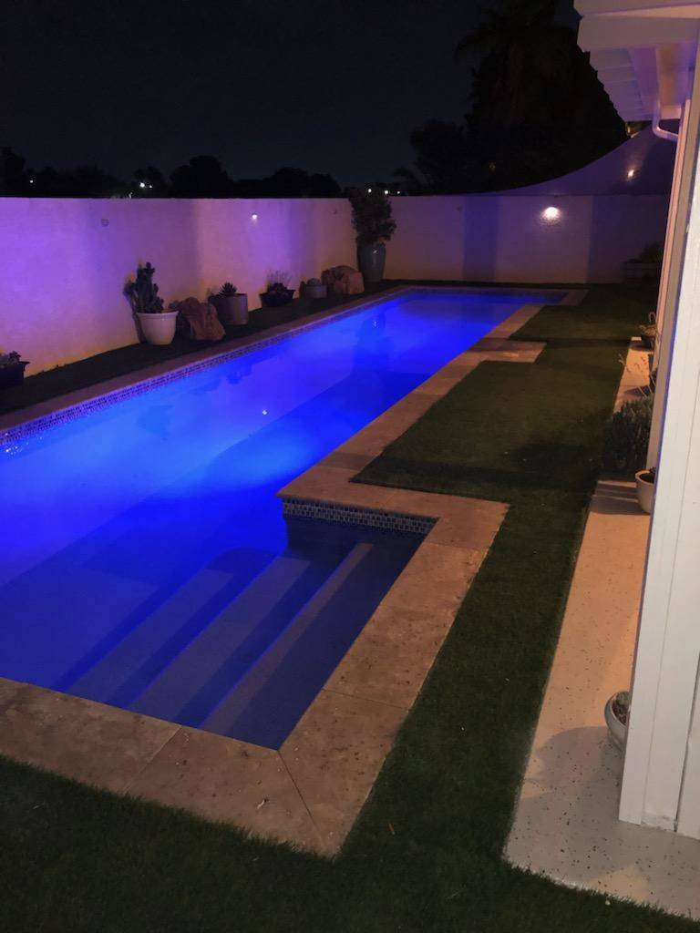 A nighttime view of the pool at 1764 Saint Thomas Drive, Henderson. (Alan Thibault)