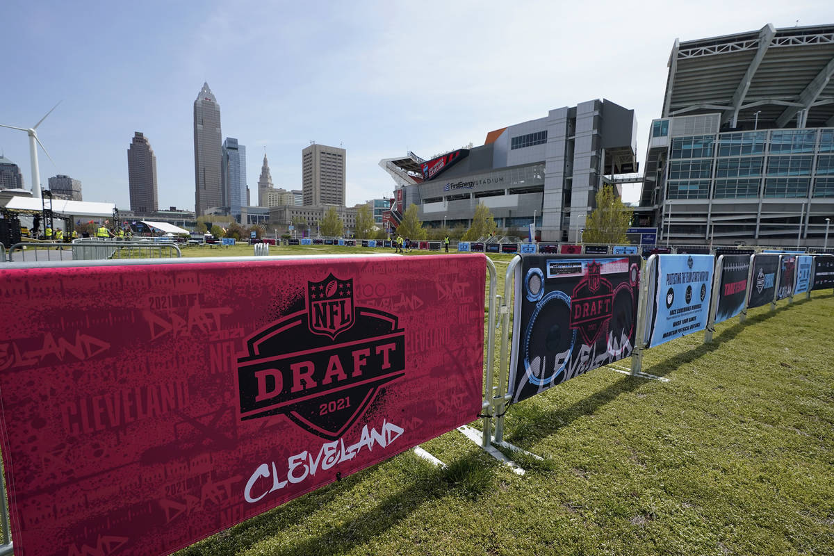 NFL Draft signs decorate the fan experience area near First Energy Stadium, Tuesday, April 27, ...