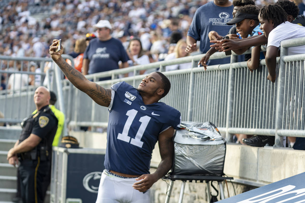 Penn State linebacker Micah Parsons (11) takes a selfie with fans in the fourth quarter of an N ...
