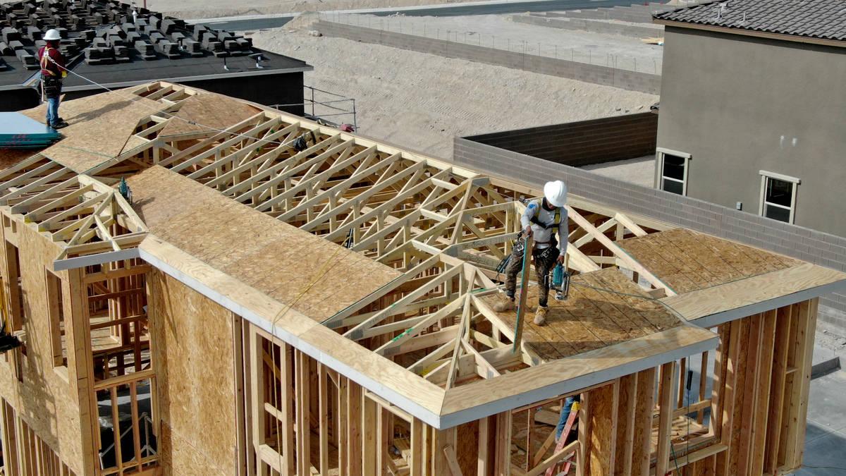 An aerial view of home construction workers in Cascades, a housing development near Far Hills A ...