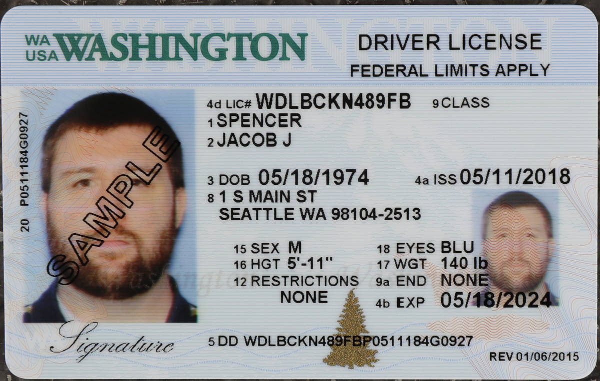 In this June 22, 2018, file photo a sample copy of a Washington drivers license is shown at the ...