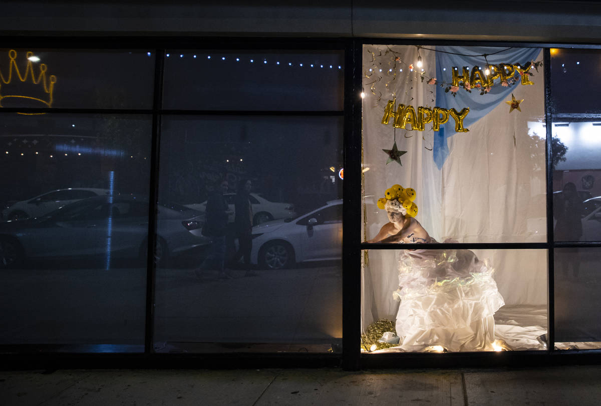 Heidi Rider performs from the windows of the Majestic Repertory Theatre in the Arts District of ...