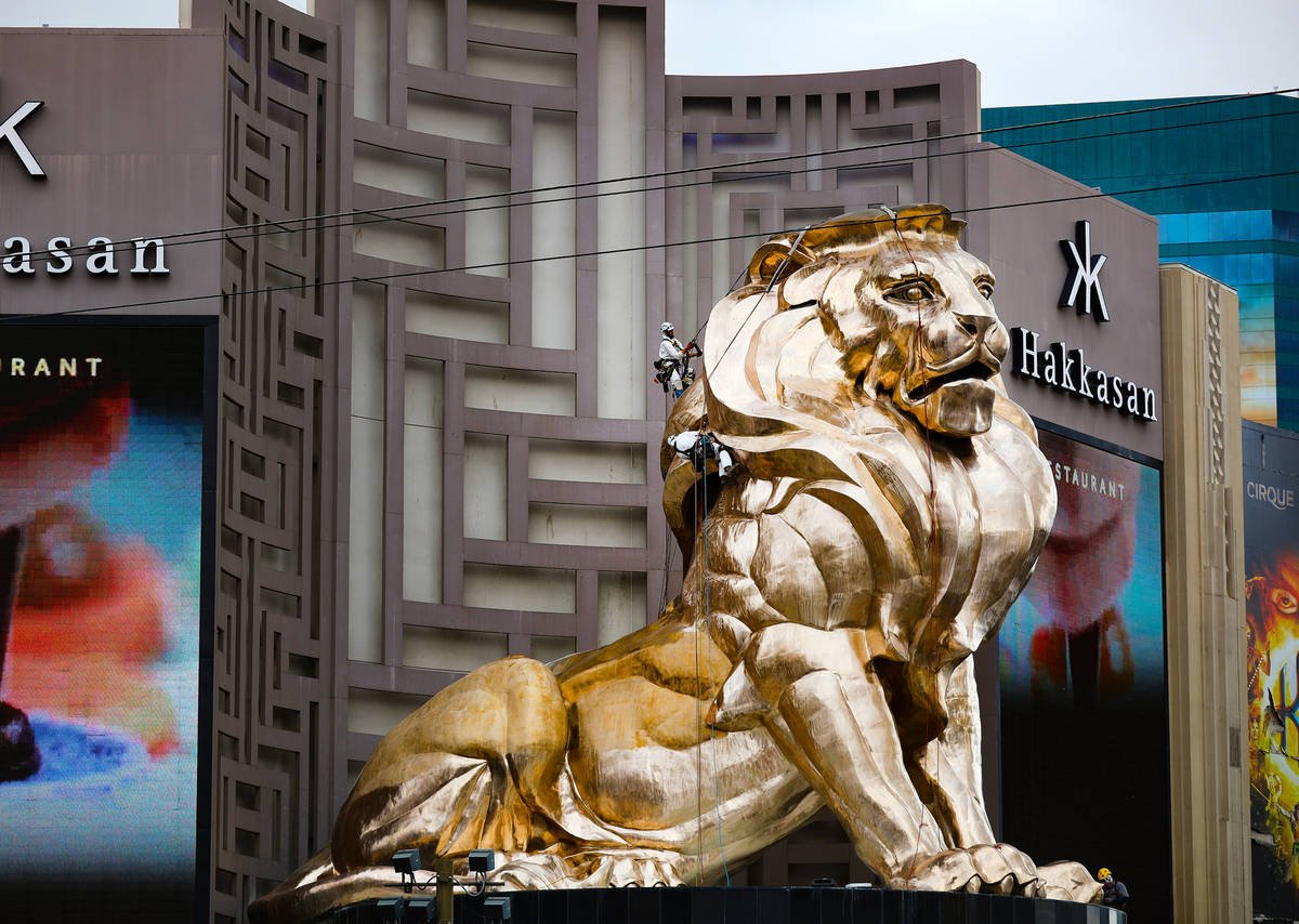 Workers buff the MGM lion statue outside the MGM Grand on Tuesday, April 27, 2021, in Las Vegas ...
