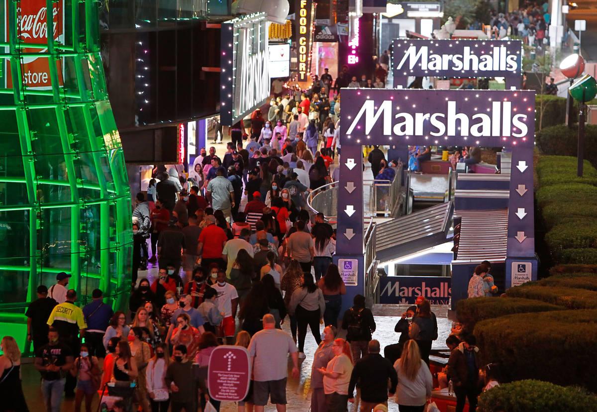 People walk along the Las Vegas Strip,, near Marshalls, Friday, March 19, 2021, in Las Vegas. ( ...