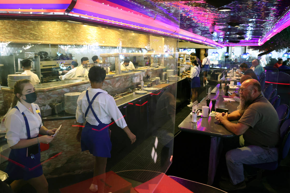 People dine at the Peppermill restaurant and Fireside Lounge in Las Vegas, Thursday, April 29, ...