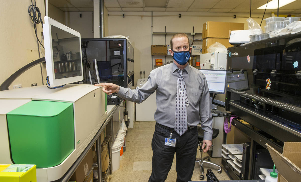 Dr. Mark Pandori, director of the Nevada State Public Health Lab, shows some of the technology ...