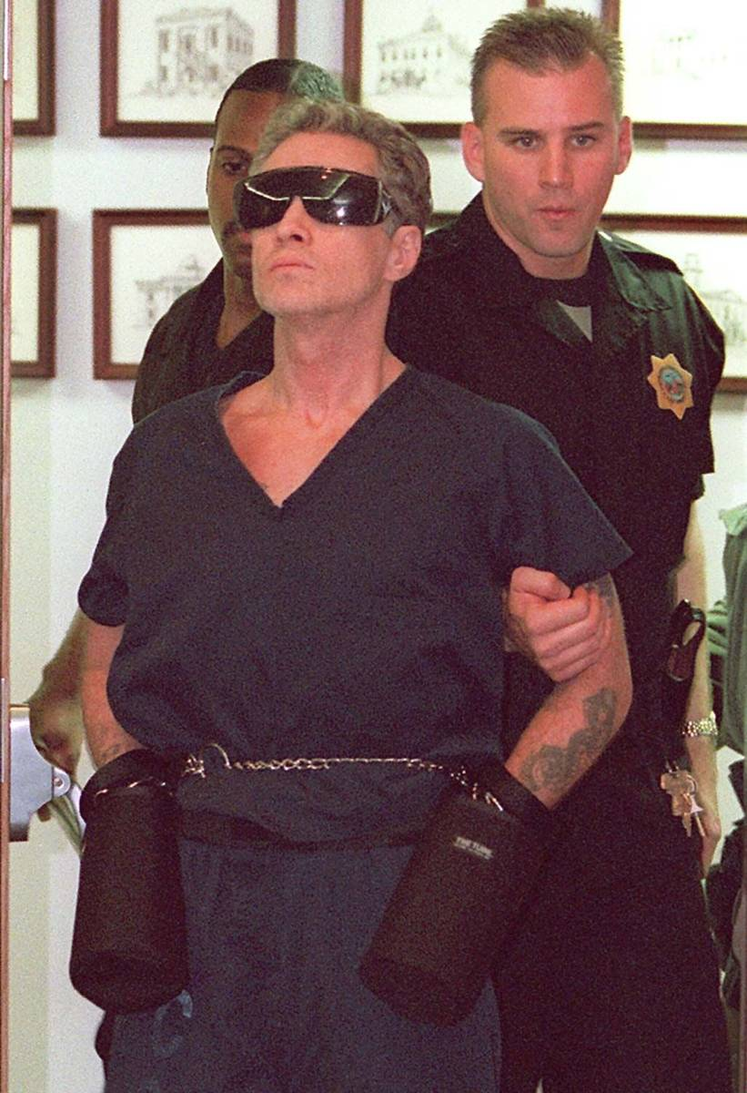 In this 1996 file photo, Patrick McKenna is brought into the court room by Metropolitan Police ...