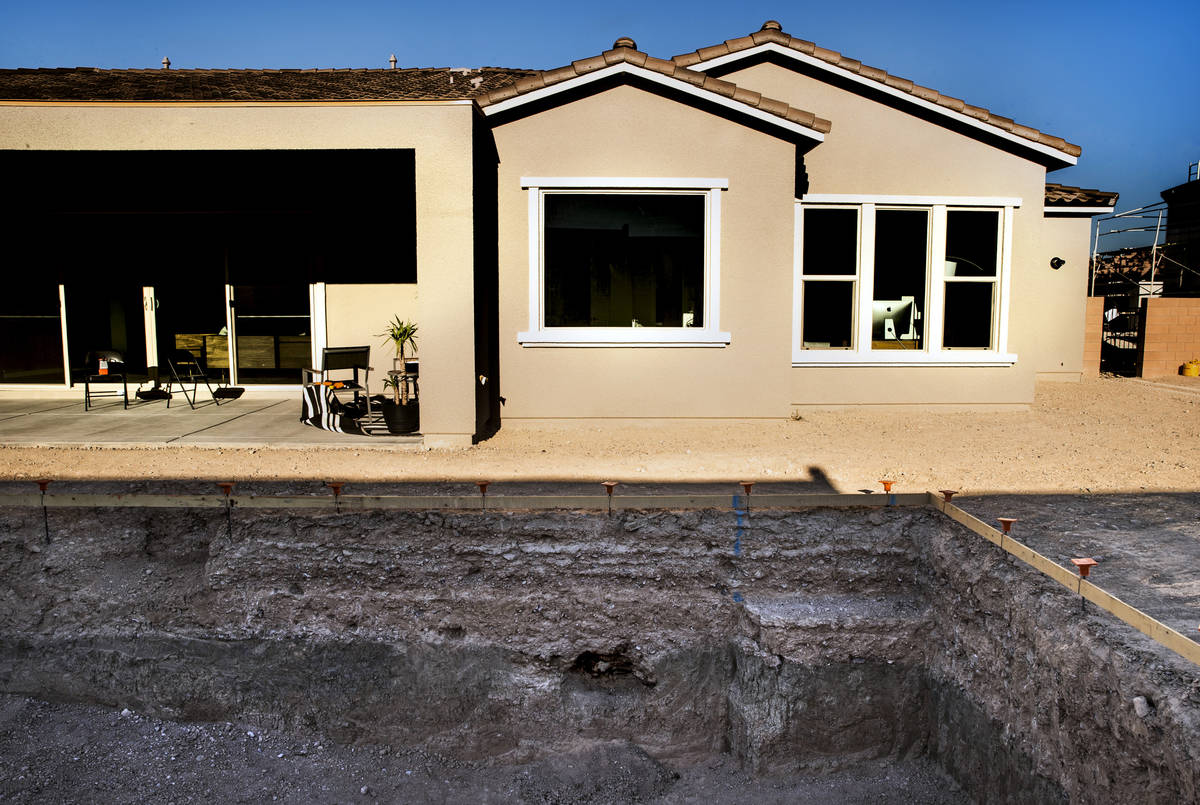 A hole in the side of their back yard pool dig reveals possible horse bones for Matt Perkins an ...
