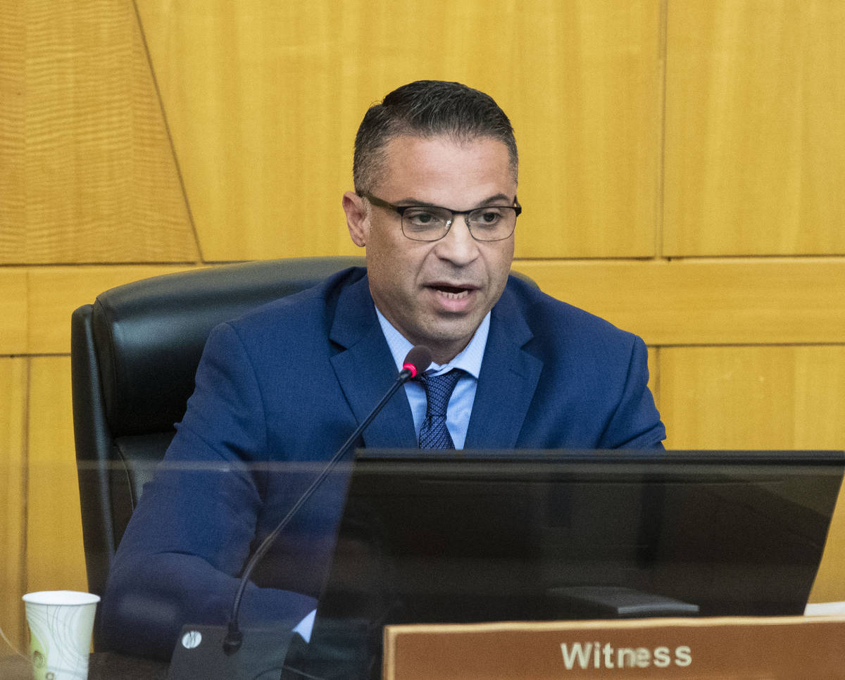 Las Vegas police Detective Mark Colon takes the witness stand at the Clark County Government Ce ...