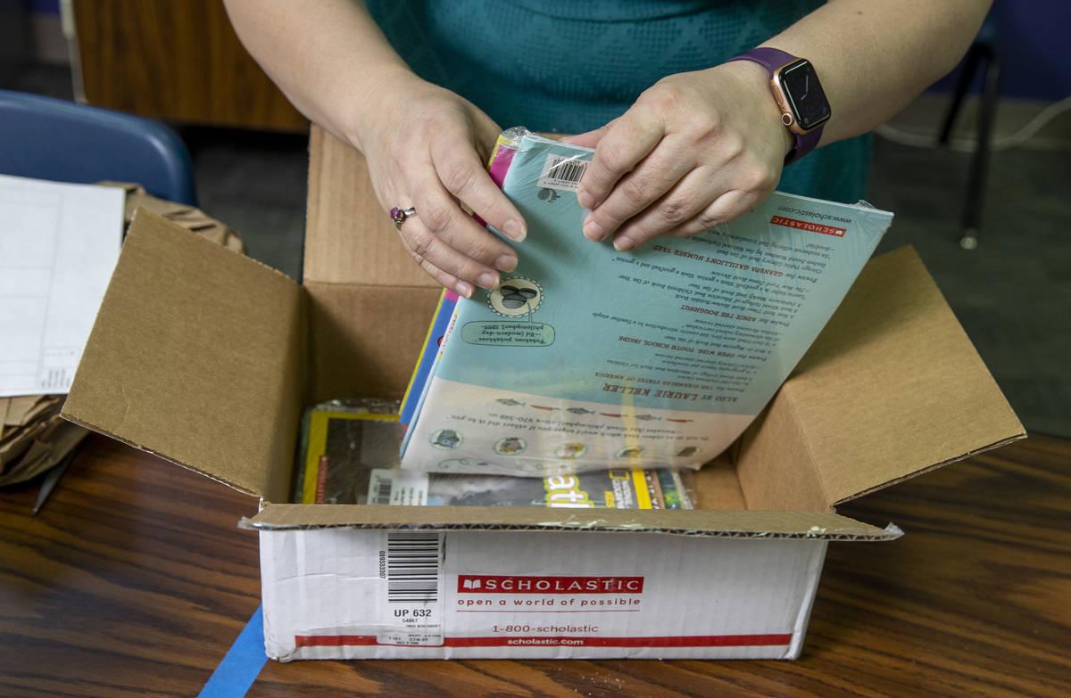 Long STEAM Academy teacher Shana Prue just received boxes of school supplies including books an ...
