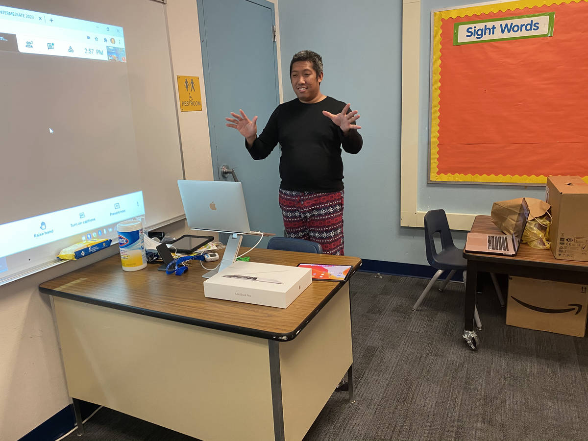 Edmon Miguel, a teacher at McWilliams Elementary School in Las Vegas, teaches his students duri ...
