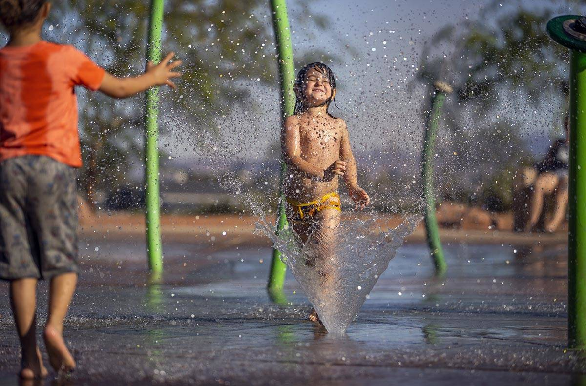 Bodhi Brown, 5, is in his happy place while playing in the water park at Bill Briare Family Par ...