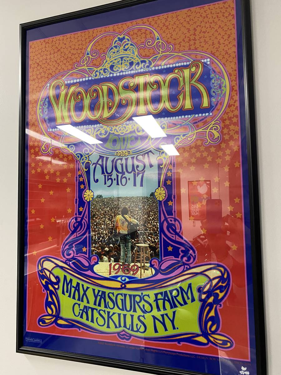 A Woodstock poster is shown at The 1960 bar at Allegiant Stadium on Thursday, April 29, 2021. ( ...