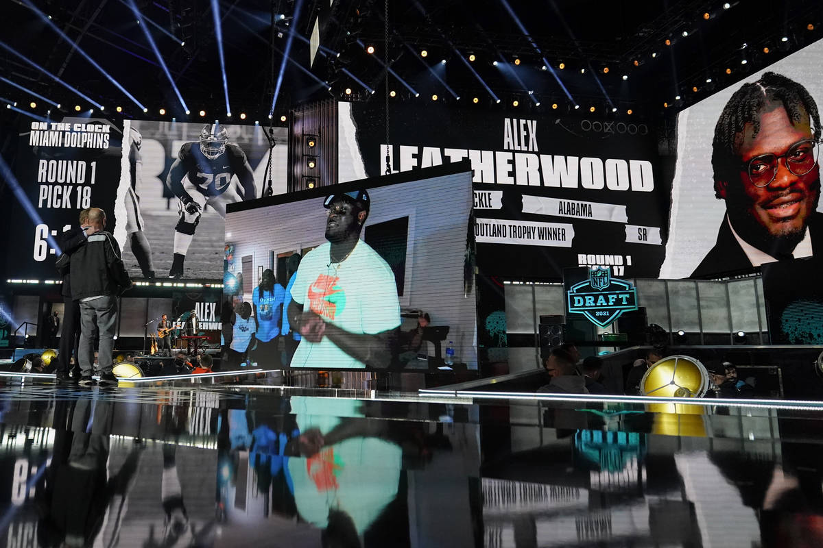 An image of Alabama tackle Alex Leatherwood is displayed on stage after he was chosen by the La ...